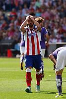 Atletico de Madrid´s Raul Garcia complains about a referee´s decission during 2014-15 La Liga Atletico de Madrid V Espanyol match at Vicente Calderon stadium in Madrid, Spain. October 19, 2014. (ALTERPHOTOS/Victor Blanco)