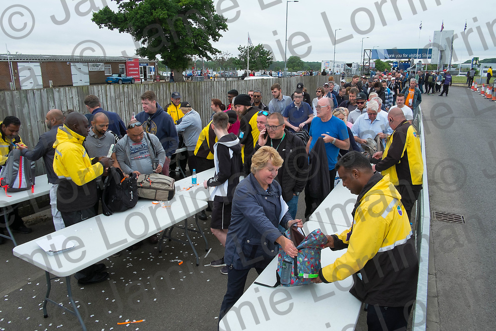 The 2017 Formula 1 Rolex British Grand Prix at Silverstone Circuit, Northamptonshire.<br /> <br /> Pictured: Crowds queue at the bag search point at the main entrance to Silverstone Circuit ahead of today's Formula 1 Grand Prix.<br /> <br /> Jamie Lorriman<br /> mail@jamielorriman.co.uk<br /> www.jamielorriman.co.uk<br /> +44 7718 900288