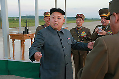 AUG 28 2014 Kim Jong Un oversees a parachuting and striking drill