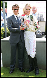 Image licensed to i-Images Picture Agency. 31/07/2014. Goodwood. United Kingdom. Tom Cruise with model Edie Campbell after he presented her with the trophy for wining the charity race  at Ladies Day at Glorious Goodwood.  Picture by Stephen Lock / i-Images