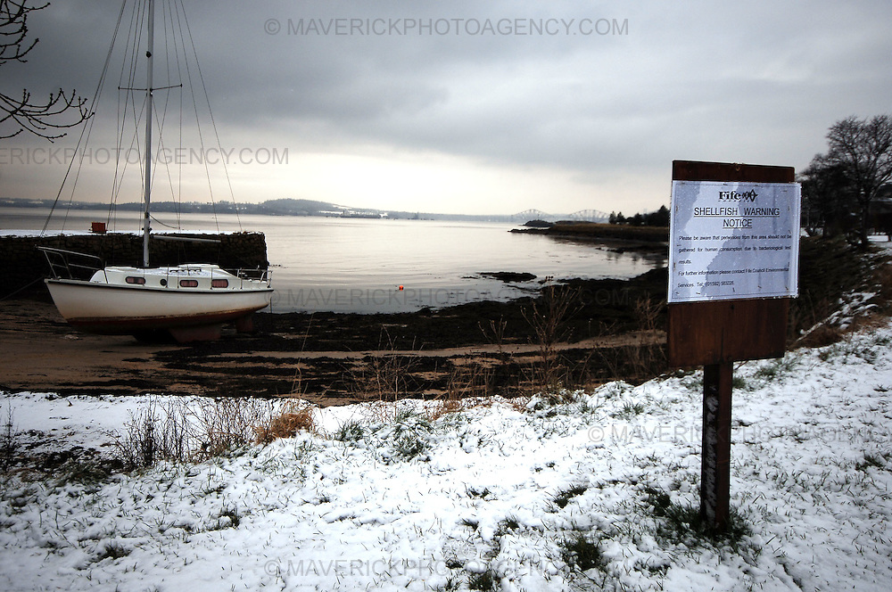 Residents in Dalgety Bay, Fife, are calling for action to clean up a beach contaminated with radioactive particles...The community council said it wants the shoreline cleared by the Ministry of Defence (MOD) within a year...Pic shows a sign at Seal Bay 500 metres along the coast from Dalgety Bay warning the public not to pick shellfish due to bacterial tests.
