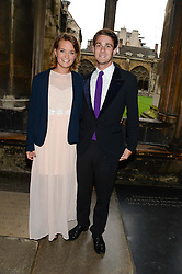 """HENRY FABER and LARA ARNOTT at a private view to view """"The Coronation Theatre: Portrait of Her Majesty Queen Elizabeth II"""" painted by Ralph Heimans held at Westminster Abbey, London on 12th September 2013."""
