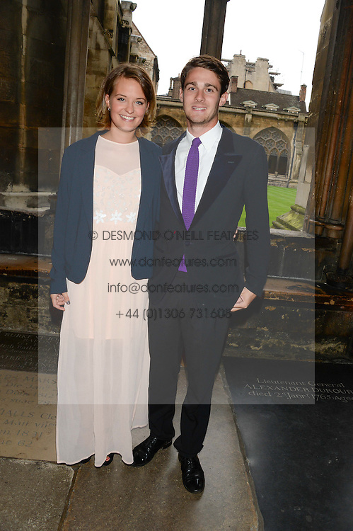 "HENRY FABER and LARA ARNOTT at a private view to view ""The Coronation Theatre: Portrait of Her Majesty Queen Elizabeth II"" painted by Ralph Heimans held at Westminster Abbey, London on 12th September 2013."
