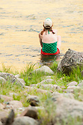 Woman enjoying the water at Johnny Walker camp during sun down on the Middle Fork of the Salmon River, Idaho.