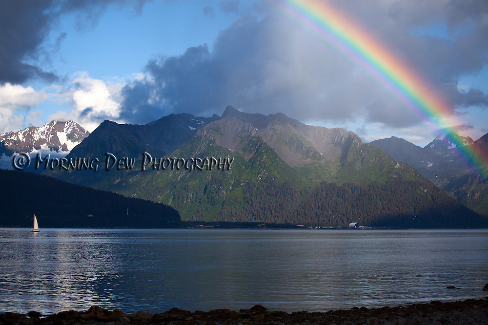 A rainbow forms over Resurrection Bay during an afternoon shower in Seward, Alaska