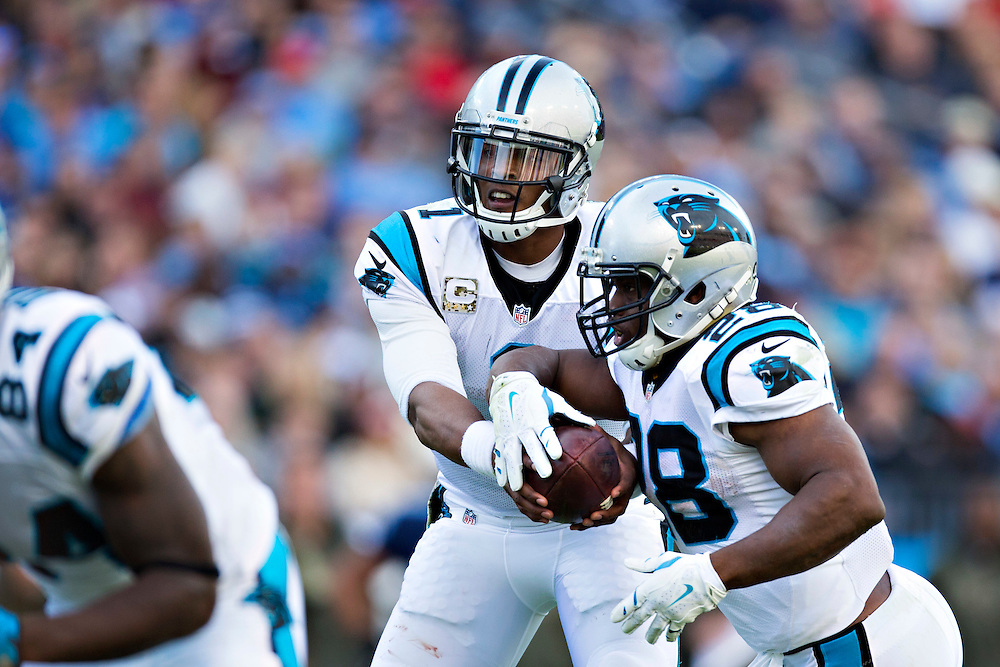 NASHVILLE, TN - NOVEMBER 15:  Cam Newton #1 hands off the ball to Jonathan Stewart #28 of the Carolina Panthers during a game against the Tennessee Titans at Nissan Stadium on November 15, 2015 in Nashville, Tennessee.  (Photo by Wesley Hitt/Getty Images) *** Local Caption *** Cam Newton; Jonathan Stewart
