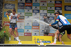 © Licenced to London 19/06/2016<br /> Kettering, Northamptonshire.UK. The winners podium with Lizzy Armitstead running for cover as Marianne Voss sprays Champagne after the final stage of the Aviva Women's Tour. Photo credit Steven Prouse/LNP