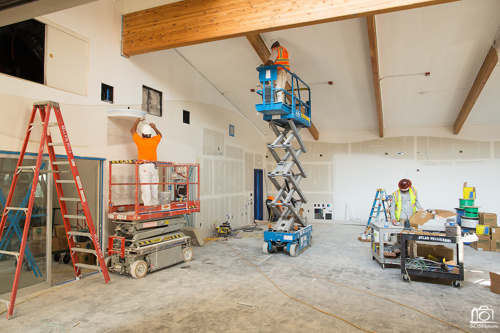 Contractors install sheetrock in the new Student Learning Center, which will replace the old cafeteria, at Marshall Pomeroy Elementary School in Milpitas, California, on August 6, 2014. (Stan Olszewski/SOSKIphoto)