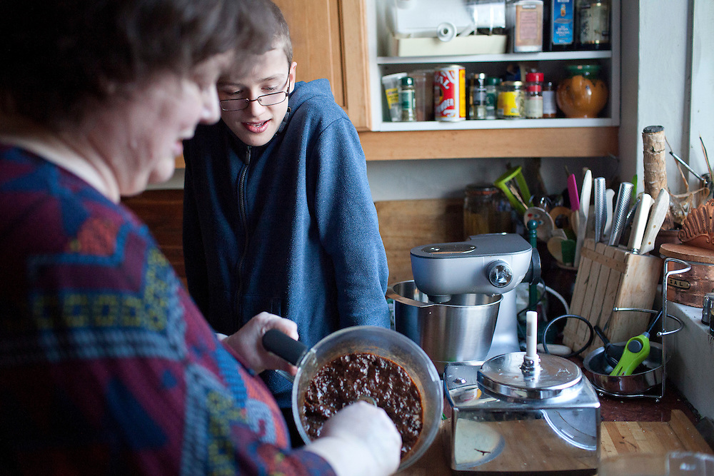 Úlfur Árnason in the kitchen with his grandmother Nanna Rögnvaldardóttir as she prepares food for the December 23 buffet  at her home in Reykjavik, Iceland, December 22, 2013.