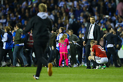 Fulham manager Slavisa Jokanovic consolidates Tim Ream of Fulham as reading fans invade the pitch at full time, Reading 1-0 Fulham - Mandatory by-line: Jason Brown/JMP - 16/05/2017 - FOOTBALL - Madejski Stadium - Reading, England - Reading v Fulham - Sky Bet Championship Play-off Semi-Final 2nd Leg