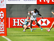 USA's Cheta Emba fights and scores the winning try  during the Emirates Dubai rugby sevens match between USA and Russia  at the Sevens Stadium, Al Ain Road, United Arab Emirates on 1 December 2016. Photo by Ian  Muir.*** during the Emirates Dubai rugby sevens match between *** and ***  at the Sevens Stadium, Al Ain Road, United Arab Emirates on 1 December 2016. Photo by Ian  Muir.