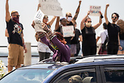 Charleston, United States. 31 May, 2020. A protester hold a sign out the window of their car during a demonstration over the death of George Floyd, along the historic Battery May 31, 2020 in Charleston, South Carolina. Floyd was choked to death by police in Minneapolis resulting in protests sweeping across the nation.  Credit: Richard Ellis/Alamy Live News