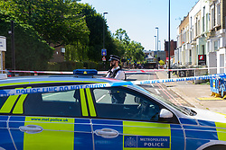 A police officer mans the cordon near the scene where a man in his 40s was stabbed on Latchmere Road in Battersea in the afternoon of July 3rd 2019, dying later that evening in hospital.. London, July 04 2019.