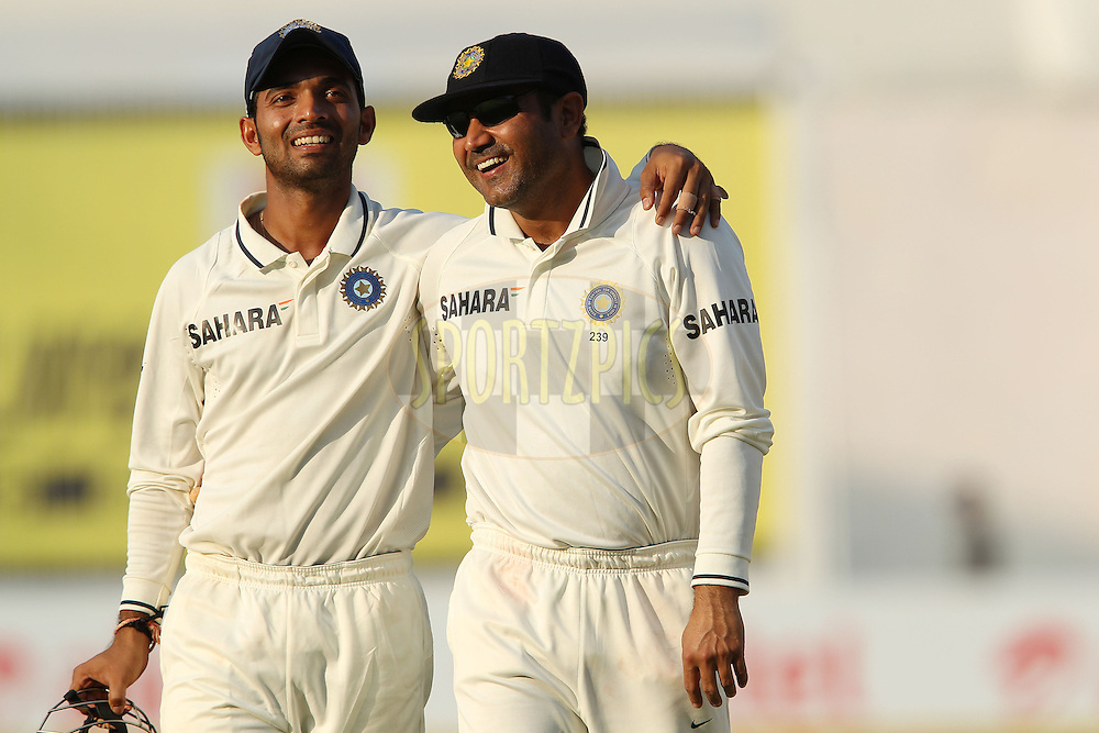 Ajinkya Rahane of India and Virender Sehwag of India share a light moment at the end of play during day three of the 1st Airtel Test Match between India and England held at the Sadar Patel Stadium in Ahmedabad, Gujarat, India on the 17th November 2012...Photo by Ron Gaunt/ BCCI/ SPORTZPICS..Use of this image is subject to the terms and conditions as outlined by the BCCI. These terms can be found by following this link:..http://www.sportzpics.co.za/image/I0000SoRagM2cIEc