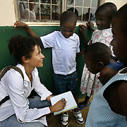 Journalist Mariane Pearl, plays with Aids orphans at the Aid Child orphanage.