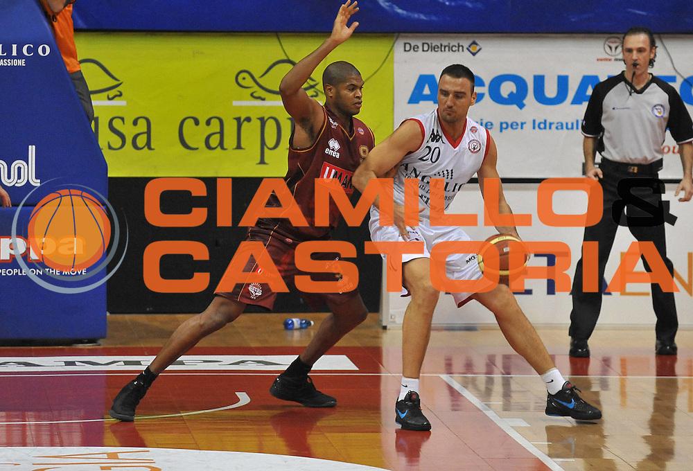 DESCRIZIONE : Biella Lega A 2011-12 Angelico Biella Umana Venezia<br /> GIOCATORE : Tamar Slay Tadija Dragicevic<br /> SQUADRA : Umana Venezia Angelico Biella<br /> EVENTO : Campionato Lega A 2011-2012<br /> GARA : Angelico Biella Umana Venezia<br /> DATA : 20/11/2011<br /> CATEGORIA : Difesa<br /> SPORT : Pallacanestro <br /> AUTORE : Agenzia Ciamillo-Castoria/ L.Goria<br /> Galleria : Lega Basket A 2011-2012 <br /> Fotonotizia : Biella Lega A 2011-12 Angelico Biella Umana Venezia<br /> Predefinita :