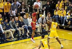 Feb 24, 2018; Morgantown, WV, USA; Iowa State Cyclones guard Terrence Lewis (24) shoots a three pointer during the first half against the West Virginia Mountaineers at WVU Coliseum. Mandatory Credit: Ben Queen-USA TODAY Sports