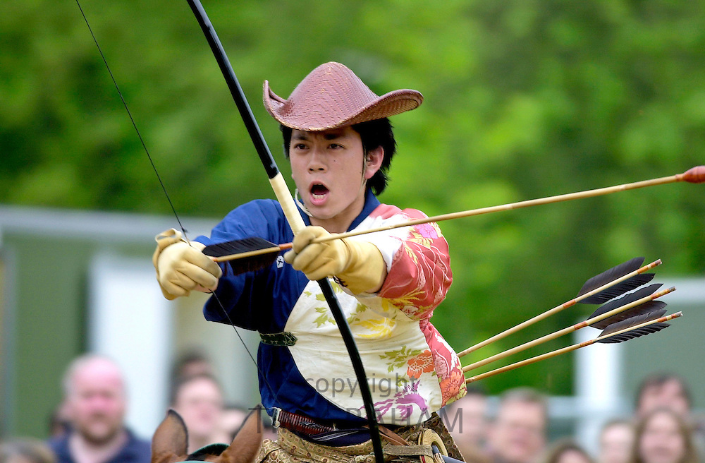JAPANESE HORSEMAN GIVING A TRADITIONAL DISPLAY OF.HORSE RIDING SKILLS AND USE OF BOW AND ARROWS DURING THE EXHIBITION ' MATSURI JAPAN IN THE PARK ' IN HYDE PARK, LONDON.