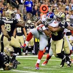 Nov 1, 2015; New Orleans, LA, USA; New York Giants running back Andre Williams (44) is tackled by New Orleans Saints inside linebacker Ramon Humber (53) during the first quarter of a game at the Mercedes-Benz Superdome. Mandatory Credit: Derick E. Hingle-USA TODAY Sports