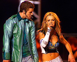 Justin Timberlake (L), from the pop music band *Nsync, and pop music star Britney Spears perform during the Super Bowl halftime show in Tampa, January 28, 2001