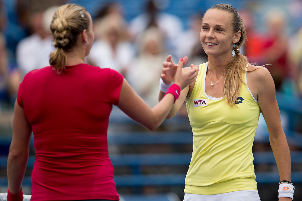 August 23, 2014, New Haven, CT:<br /> Petra Kvitova and Magdalena Rybarikova high five at net after the singles final on day nine of the 2014 Connecticut Open at the Yale University Tennis Center in New Haven, Connecticut Saturday, August 23, 2014.<br /> (Photo by Billie Weiss/Connecticut Open)