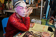 """Famed Cantonese Opera actor LAW Kar-ying in his dressing room making up before the Opera """"Execution of the Duke's Second Brother"""" performed at the West Kowloon Bamboo theatre."""