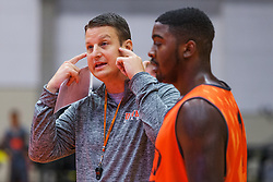 UPike Men's head basketball coach Kelly Wells, right, talks with forward Christian Leach, right during team workouts, Wednesday, Sept. 24, 2014 at the Eastern Kentucky Expo Center in Pikeville. <br /> <br /> Photo by Jonathan Palmer, Special to the CJ