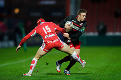 Edinburgh Winger (#14) Dougie Fife is challenged by Gloucester Full Back (#15) Rob Cook during the first half of the match - Photo mandatory by-line: Rogan Thomson/JMP - Tel: 07966 386802 - 15/12/2013 - SPORT - RUGBY UNION - Kingsholm Stadium, Gloucester - Gloucester Rugby v Edinburgh Rugby - Heineken Cup Round 4.