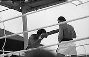 Ali vs Lewis Fight, Croke Park,Dublin..1972..19.07.1972..07.19.1972..19th July 1972..As part of his built up for a World Championship attempt against the current champion, 'Smokin' Joe Frazier,Muhammad Ali fought Al 'Blue' Lewis at Croke Park,Dublin,Ireland. Muhammad Ali won the fight with a TKO when the fight was stopped in the eleventh round...Picture of Lewis as he lands a left into the Ali chest.