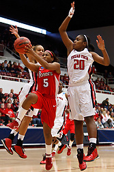 March 19, 2011; Stanford, CA, USA; St. John's Red Storm guard Nadirah McKenith (5) shoots past Texas Tech Lady Raiders forward/center Kierra Mallard (20) during the first half of the first round of the 2011 NCAA women's basketball tournament at Maples Pavilion. St. John's defeated Texas Tech 55-50.