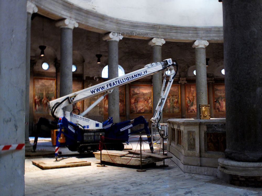San Stefano Rotondo, interior under repair.  Built 5th century.  Part of colonnade with Ionic capitals; small crane parked in the center.