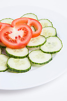 Close-up  of sliced tomatoes and cucumbers in plate