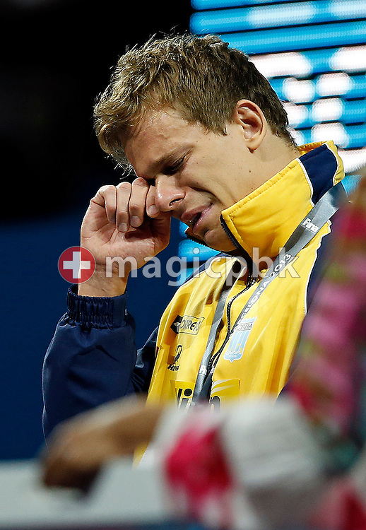 Cesar Cielo Filho of Brazil cries during the award ceremony after winning the men's 50m Freestyle Final during the 15th FINA World Aquatics Championships at the Palau Sant Jordi in Barcelona, Spain, Saturday, Aug. 3, 2013. (Photo by Patrick B. Kraemer / MAGICPBK)