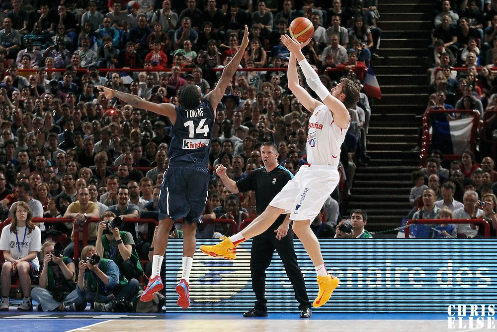 15 July 2012: Pau Gasol of Team Spain takes a jumpshot over Ronny Turiaf of Team France during a pre-Olympic exhibition game won 75-70 by Spain over France, at the Palais Omnisports de Paris Bercy, in Paris, France.