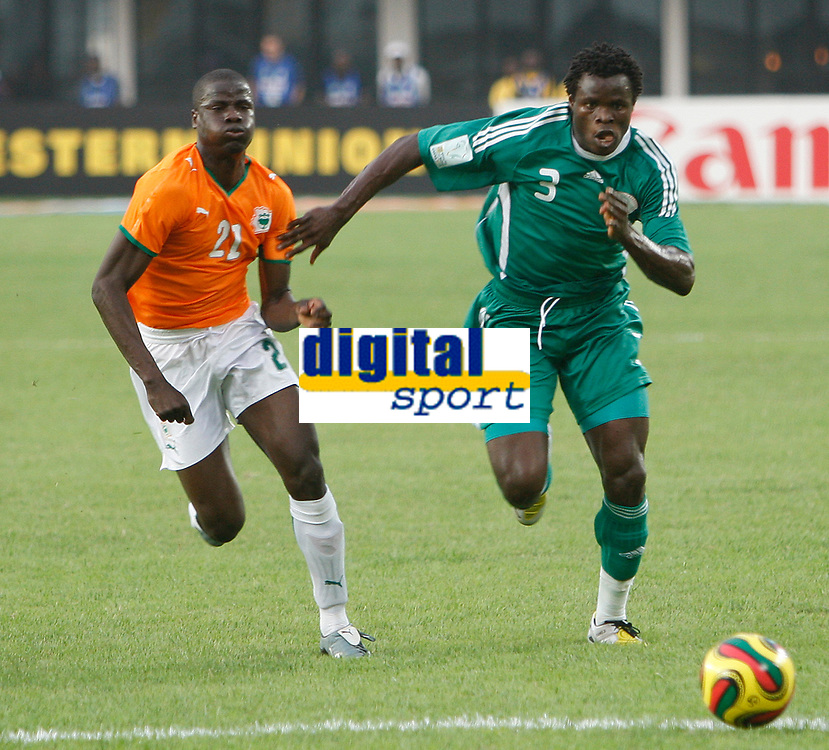 Photo: Steve Bond/Richard Lane Photography.<br />Nigeria v Ivory Coast. Africa Cup of Nations. 21/01/2008. Taiwa Taye (R) races for the ball with struggling Emmanuel Eboue (L)