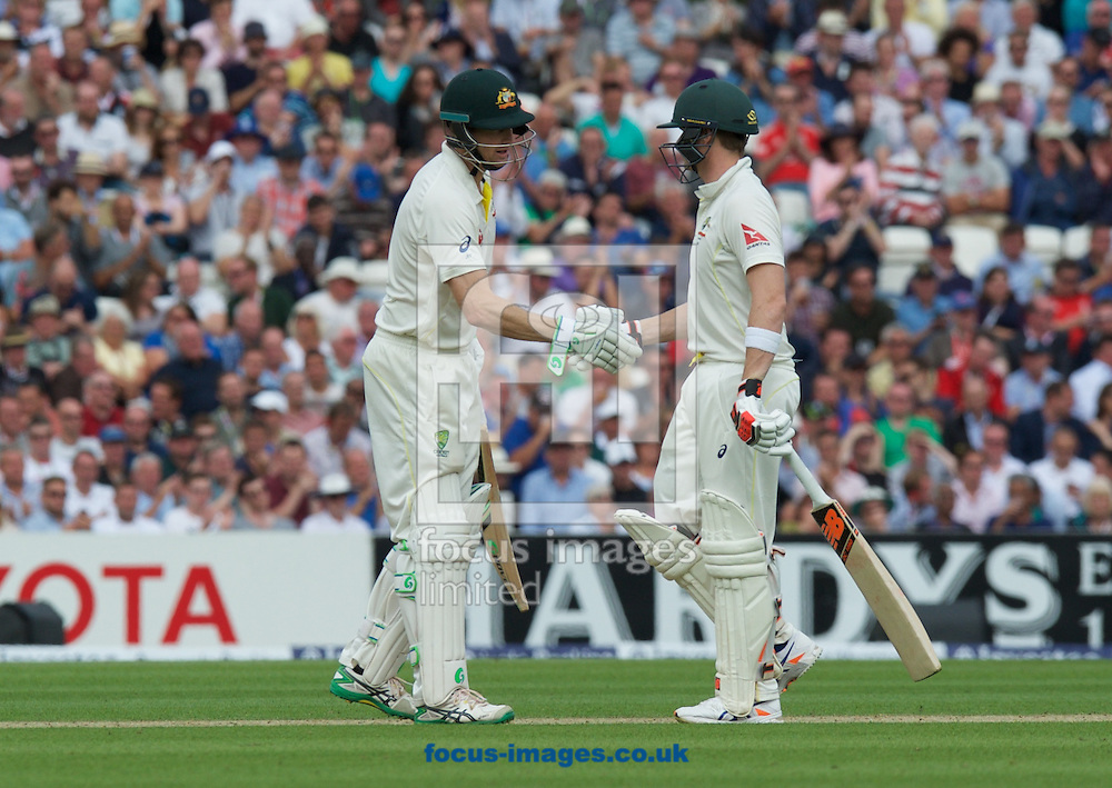 Steven Smith (left) of Australia is congratulated on his 50 by Adam Voges during the 5th Investec Ashes Test Match match at the Kia Oval, London<br /> Picture by Alan Stanford/Focus Images Ltd +44 7915 056117<br /> 20/08/2015