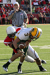 16 October 2010:  Jose Mohler loses the ball as he is wrapped up by Josh Howe during a game where the North Dakota State Bison lost to the Illinois State Redbirds 34-24, meeting at Hancock Stadium on the campus of Illinois State University in Normal Illinois.