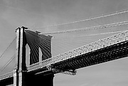 """The Brooklyn Bridge, photographed from a water taxi.. This mage can be licensed via Millennium Images. Contact me for more details, or email mail@milim.com For prints, contact me, or click """"add to cart"""" to some standard print options."""