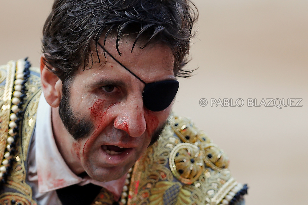 PAMPLONA, SPAIN - JULY 13: Bullfighter Juan Jose Padilla performs with a Fuente Ymbro's fighting bull on the eighth day of the San Fermin Running Of The Bulls festival on July 13, 2013 in Pamplona, Spain. The annual Fiesta de San Fermin, made famous by the 1926 novel of U.S. author Ernest Hemmingway 'The Sun Also Rises,' involves the running of the bulls through the historic heart of Pamplona, this year for nine days from July 6-14.  (© Pablo Blazquez)