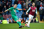 Bournemouth goalkeeper Aaron Ramsdale (12) clears from the onrushing Burnley forward Jay Rodriguez (19) during the Premier League match between Burnley and Bournemouth at Turf Moor, Burnley, England on 22 February 2020.