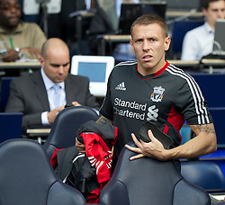 LONDON, ENGLAND - Sunday, September 18, 2011: Liverpool's substitute Craig Bellamy sits on the bench before the Premiership match against Tottenham Hotspur at White Hart Lane. (Pic by David Rawcliffe/Propaganda)