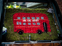 © Licensed to London News Pictures. 25/08/2015. London, UK. A bus wreath is placed in the hearse for The funeral of Stephen Lewis, who played Inspector Cyril 'Blakey' in the sitcom TV series, On The Buses. He died on Wednesday the 12th of August 2015 aged 88. The funeral was held today, the 25th August 2015 at Our Lady Of Lourdes Church in Wanstead, east London. Photo credit: Pete Maclaine/LNP