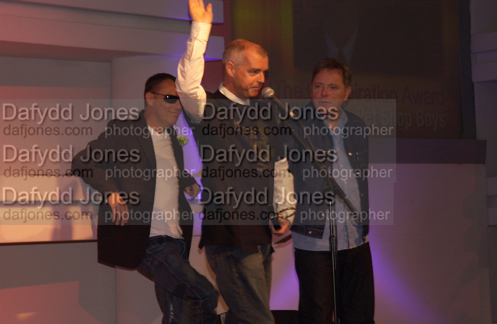 Chris Lowe, Neil Tennant, Bernard Sumner, The Q Awards 2004, Grosvenor House, London. 4 October 2004. ONE TIME USE ONLY - DO NOT ARCHIVE  © Copyright Photograph by Dafydd Jones 66 Stockwell Park Rd. London SW9 0DA Tel 020 7733 0108 www.dafjones.com