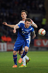 Andy King of Wales (Leicester City) jostles for the ball with Aron Einar Gunnarson (Cardiff City) of Iceland  - Photo mandatory by-line: Dougie Allward/JMP - Tel: Mobile: 07966 386802 03/03/2014 -