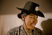 U.S. Army Staff Sgt. Laura Milagros stands inside the building where trainees get their initial briefings during basic military training at Fort Jackson, S.C., on October 23, 2008.