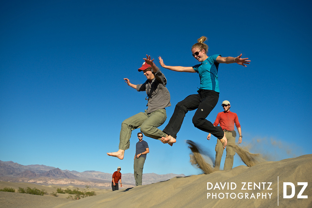 University of Texas Austin students Sarah Coyle, left, and Maren Mathisen, leap off a dune as fellow students, from left, Nick Perez, Gordon Smith and Sebastian Ramirez, look on at the Mesquite Flat Sand Dunes in Death Valley National Park, Calif., on Oct. 25, 2012. The graduate students, who were there studying the park's geology, were blowing off steam at the end of their trip before heading back to Texas.