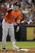 PHOENIX, AZ - AUGUST 15:  Alex Bregman #2 of the Houston Astros holds up three fingers after hitting an RBI triple against the Arizona Diamondbacks in the second inning at Chase Field on August 15, 2017 in Phoenix, Arizona.  (Photo by Jennifer Stewart/Getty Images)