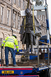 The sculpture of Sherlock Holmes by former pop-artist Gerald Laing is being moved from it's home on Picardy Place, yards from the birth place of Sir Arthur Conan Doyle.<br /> <br /> The move of the sculpture is to accommodate road and tram works that are taking place in Edinburgh. The statue will be moved to Nairn at  Black Isle Bronze Ltd by the artists son, Farquhar Laing where it will stay for two years until it returns to Edinburgh.<br /> <br /> Pictured: The Sherlock Holmes statue mid-air as it is lifted onto the truck that will take it back to Nairn where it was cast.