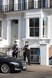 © Licensed to London News Pictures. 13/09/2016. London, UK. Armed police stand on guard outside the house of Former Prime Minister David Cameron on the day after he resigned as an Member of Parliament. Photo credit: Peter Macdiarmid/LNP