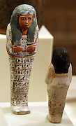 Two Uschebtis with hoes and grain sacks New Kingdom, 18th and 20th Dynasty around 1500 BC and 1100 BC Western Thebes, limestone, painted.